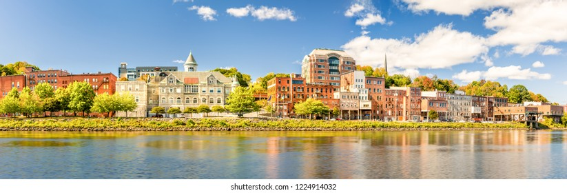 Augusta skyline panorama on a sunny afternoon (long exposure for smooth sky and water). Augusta is the state capital of the U.S. state of Maine and the county seat of Kennebec County
