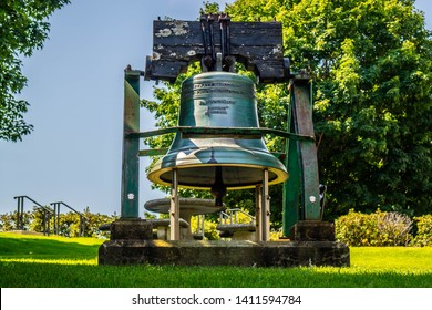 Augusta State Capital, ME, USA - August 8, 2018: The huge Liberty Bell along the grounds of Augusta State Capital
