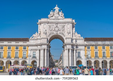Augusta Street Arch in Commerce Square in Lisbon wiht unidentified blurred tourists, Portugal