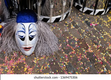 Augustinergasse, Basel, Switzerland - March 12th, 2019. Close-up of a carnival mask and snare drums on a confetti covered street