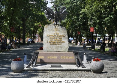 AUGUSTOW. POLAND. 23 JUIY 2014 : Monument to freedom fighters at Sigismund II Augustus square in Augustow. Poland