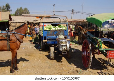 AUNG BAN, BURMA - FEB 28, 2015 - Horse cart and  tractor make deliveries to the weekly wholesale market in  Aung Ban,  Myanmar (Burma)