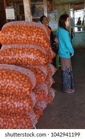 AUNG BAN, BURMA - FEB 28, 2015 - Wholesale bags of onions at the weekly market in  Aung Ban,  Myanmar (Burma)