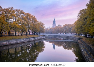 Aura river and beautiful fall foliage with Turku Cathedral in the background in Turku, Finland