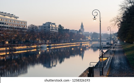 Aurajoki river in hazy autumn morning with Turku Cathedral aka Turun Tuomiokirkko in background in Turku, Finland