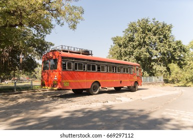 Aurangabad, India - NOV 25, 2016: Indian school bus is parked near Ellora Caves.