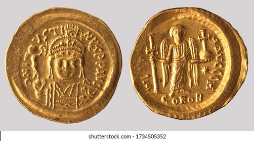 Aureus (Greece Gold Coin), Obverse:  Bust of the emperor Justin II holding globus with Nike. Reverse:  Angel standing holding cross and globus cruciger.