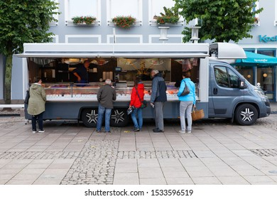Aurich, Lower Saxony/Germany-September 27, 2019: Mobile Food Truck selling fish at the popular market place in Aurich