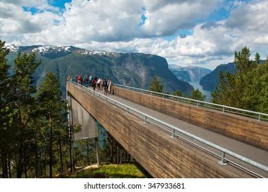AURLAND, NORWAY - JULY 2, 2014: Tourists On Stegastein Viewpoint, Sogn Og Fjordane, Aurland, Norway.