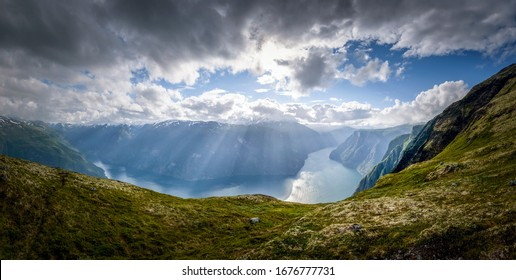 Aurlandsfjord panorama in glorious sunshine at a cloudy day Norway