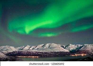 Aurora above fjords in Norway