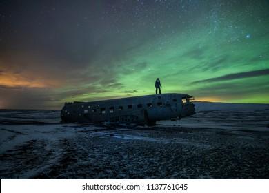 Aurora Borealis behind the Solheimasandur Plane Wreck, Iceland
