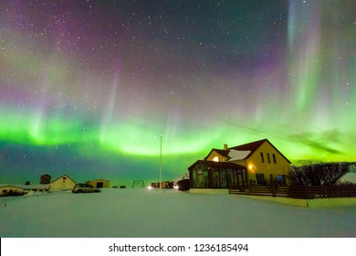 Aurora Borealis or better known as The Northern Lights for background view in Iceland, Reykjavik during winter