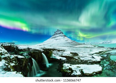 Aurora Borealis or northern light above kirkjufell mountain in iceland