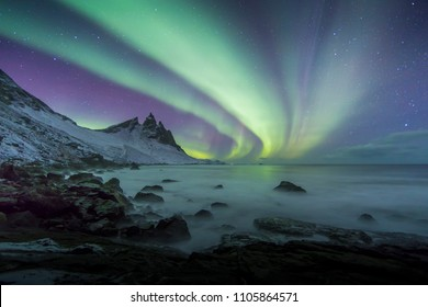 Aurora Borealis (Northern Lights) above Stokksnes Beach and Vestrahorn Mountains, Iceland