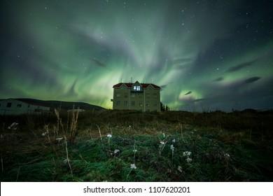 Aurora Borealis (Northern Lights) above a haunted house