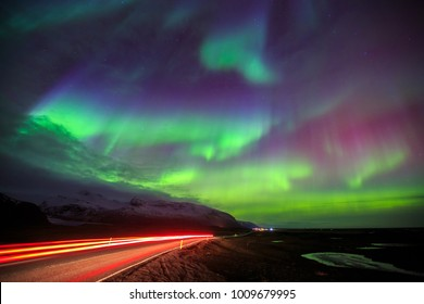 Aurora Borealis or the Northern lights appear over the mountain near Skaftafell in Vatnajokull National Park, South region, Iceland.