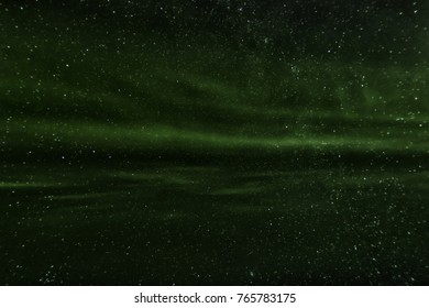 Aurora Borealis Northern Lights in the icelandic Sky at winter nighttime