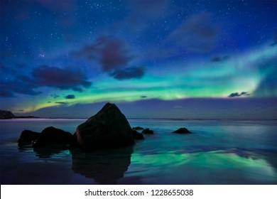 Aurora borealis northern lights on Skagsanden beach. Lofoten Islands, Norway