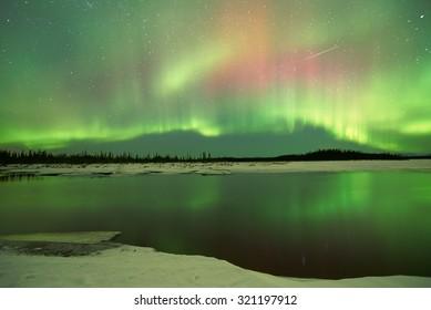 Aurora Borealis Northern Lights over lake in Fairbanks Alaska
