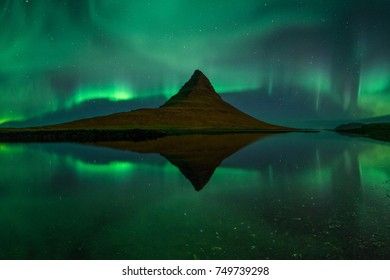 Aurora borealis (Northern Lights) reflection at Kirkjufell, Western Iceland during a Solar Storm.
