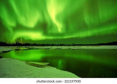 Aurora Borealis Northern Lights reflections in lake in Fairbanks Alaska