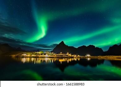 Aurora Borealis, northern lights at Reine, Lofoten islands, Norway