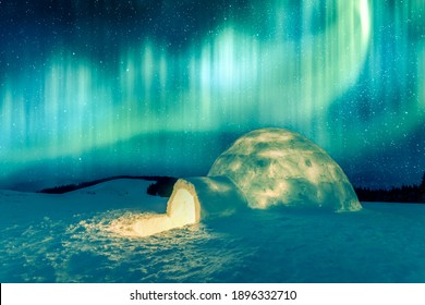 Aurora borealis. Northern lights in winter mountains. Wintry scene with glowing polar lights and snowy igloo. Landscape photography