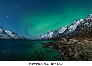 Aurora Borealis in Norway with reflection
