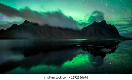 Aurora Borealis on display at the iconic Vestrahorn mountain in Stokksnes, East Iceland.