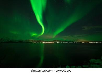 Aurora borealis on fjord in Norway