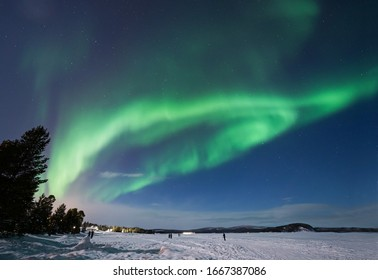Aurora Borealis over Lake Inari near Inari town in Lapland in Northern Finland.