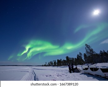 Aurora Borealis over Lake Inari in Lapland in Northern Finland.