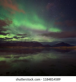 Aurora borealis over the mountain lake