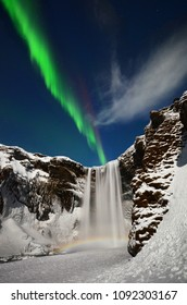 Aurora borealis over Skogarfoss with Moonbow