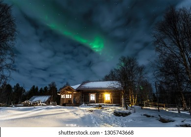 Aurora borealis over the village of Nilmoguba on the White sea coast, Russia