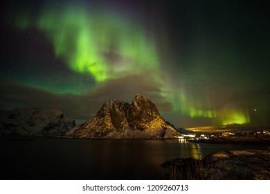 Aurora borealis (Polar lights) over the Reinefjorden - Raine, Lofoten islands, Norway