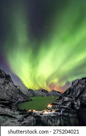 Aurora borealis (Polar lights) over the mountains in the North of Europe - Mefjord, Lofoten islands, Norway