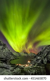 Aurora borealis (Polar lights) over the mountains in the North of Europe - Senja Island, Troms, Norway