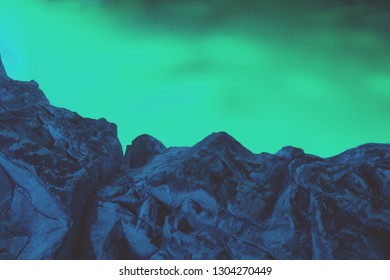 Aurora Borealis sky and silhouette of mountain ridge