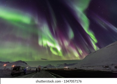 Aurora borealis with snow mountains.