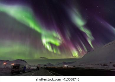 Aurora borealis with snow mountains.