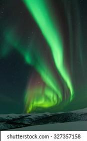 Aurora Borealis and winter landscape