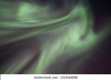 Aurora Borealis-The Northern Lights in Iceland high in the sky. The amazing natural wonder of the world