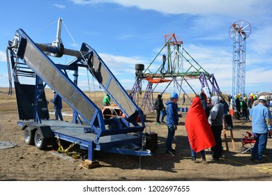 Aurora, CO, USA, Oct, 6, 2018. Pumpkin Chunkin Event at the Arapahoe County Racetrack. Teams from all over compete to see how far they can shoot or catapult a pumpkin. Large crowds come to watch.