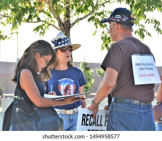 Aurora, CO, USA. Sep 2, 2019. Michelle Malkin, a TV personality, author and syndicated columnist signs the Colorado Governor Jared Polis recall petition at the Stand for ICE Rally.