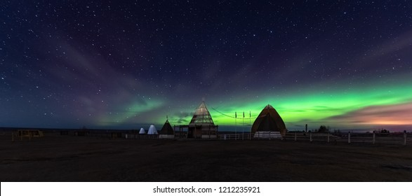 Aurora display in Yakutsk. The polar Northern lights aurora borealis sky star in Yakutia, Siberia, in place of the cult summer festivity Yhyakh Tuymaady of Yakuts, of the people of Yakutia