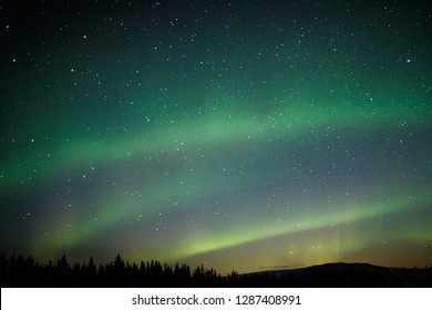 Aurora light on the winter sky in Alaska, magical night show, natural theather