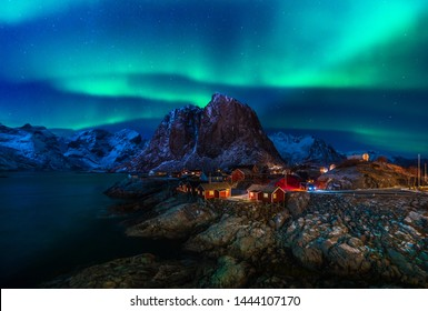 Aurora lights are dancing over the sky at a small fishing village, named Hamnoy, located in Moskenes Municipality, Lofoten, Norway