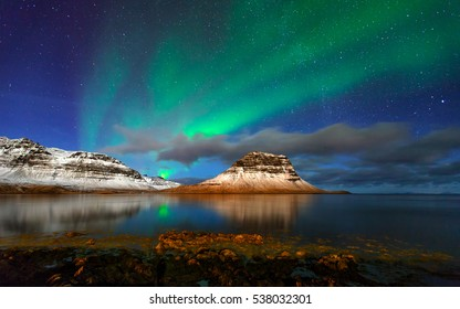Aurora( Northern light) and snowy mountain in Iceland